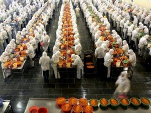 Workers labor to produce canned tangerine to be exported at the Huangyan No 1 Canned Food Factory in Huangyan, eastern China's Zhejiang province Wednesday Dec. 12, 2007. China has taken a series of steps to crack down on tainted and unsafe products after various foods, medicines and other items ranging from toothpaste to seafood were found to contain potentially deadly substances.  (AP Photo) ** CHINA OUT **
